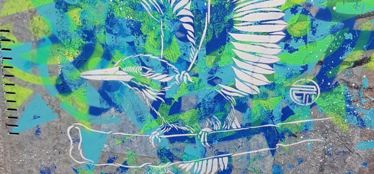 Fugl på blågrønn bakgrunn